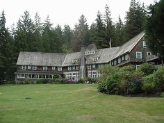 The main lodge overlooks a large lawn area surrounded by towering. Quinault, WA