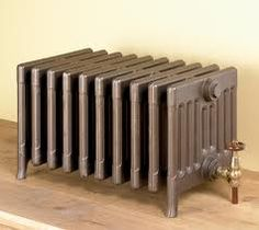 Old School House Radiator  The best way to get mittens and boots warm/dry before the next recess.