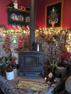 I love the old crocks and hanging stockings. The wall color is great! Corner Wood Stove, Wood Stove Hearth, Stove Fireplace, Wood Burner, Cozy Fireplace, Wood Stove Decor, Corner Mantle, Wood Stove Wall, Wood Stove Surround