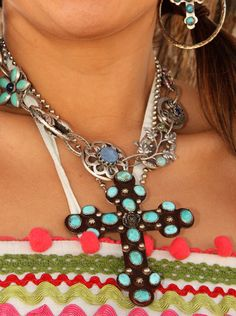 this OLD MEXICO cross is handcrafted from sterling silver and chunks of turquoise . .   this pendant will slip over any NECKLACE or chain or leather cord you like!