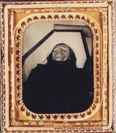 picture of a dead Edgar Allen Poe in his casket.