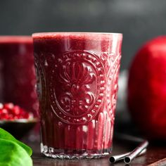 This Beet & Pomegranate Smoothie with Spinach is a beautiful and healthy breakfast recipe that uses the best winter produce! Paleo, & vegan w/no refined sugar!