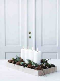 Nice Christmas arrangement with eucalyptus, candles, pinecones, and such. Not at all overdone.