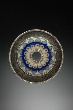 Kristina Logan: flameworked glass pendant/brooch, sterling silver, 5 cm. photo: Dean Powell