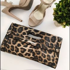 Nine West leopard clutch A flap-over, magnetic top with a cut-out handle completes the look of this clutch.  12 inches long x 6.5 inches wide x 1 inches deep •fast shipping & discounts on bundles Nine West Bags Clutches & Wristlets