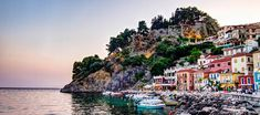 Amphitheatrically set on the outskirts of the Venetian castle, the picturesque and cosmopolitan town of Parga offers majestic panoramic views to the Ionian Sea. Dark Fantasy, Greek Town, Greece Hotels, Heaven's Gate, Holiday Planner, Greece Holiday, Mountain Village, Seaside Resort, Greece Travel