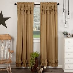 Hang our Simple Life Flax Khaki Ruffled Panel Set in your home to add a delicate, romantic look to your living space. Woven with cotton and linen flax, the sturdy, textured fabric paired with fanciful ruffles draws the eye. These 84x40 curtains in dark khaki provide a cozy yet sophisticated touch to your farmhouse decor. Lined with white cotton, these elegant drapes help reduce sunlight and include tiebacks for days you prefer more natural light. Features PREMIUM CONSTRUCTION: with over two…