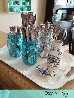 Organization in a small kitchen | Diy beautify Use pretty jars to store utensils; when corralled on a decorative tray, it's storage and decor in one! See more at http://diybeautify.blogspot.com/2014/01/organizationinasmallkitchen.html#axzz2qDeJifQL