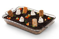 Also Known As: GHOSTS IN THE GRAVEYARD No need to fear this graveyard: It's made with chocolate pudding and crushed cookies! See it all come together in this super-quick video.