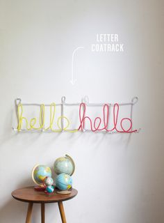 """Letter Coat Rack DIY - Super cute and super easy to adapt. I think I might make an """"Amber & Matt"""" one for our bedroom wall."""