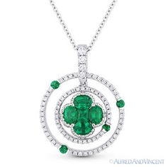 The featured pendant is cast in 18k white gold and showcases a flower set with a princess cut & 4 oval cut emeralds accentuated by round cut diamonds & emeralds set all the way around the circles and on the bale.