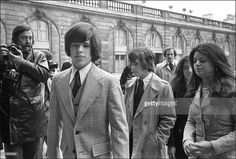 Timothy Shriver (L), enters the Elysee Palace, followed by John F. Kennedy Jr., Maria Shriver (R), and Caroline Kennedy in the background, Paris, 21 March 1975.