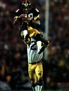 Wide receiver Lynn Swann leaps above a Los Angeles Rams defender to secure a catch during Pittsburgh's victory in Super Bowl XIV, in But Football, Pittsburgh Steelers Football, Pittsburgh Sports, Dallas Cowboys, Football Players, Steelers Team, Funny Football, Steelers Pics, Here We Go Steelers