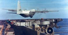 An Amazing/Crazy Pilot: US Hercules Plane Lands On & Takes Off From An Aircraft Carrier