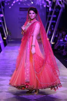 Tarun Tahiliani Lakme Fashion Week Summer Resort 2014 Jaqueline Fernandez in Indian bridal pink suit. See all Fashion Week photos here: http://www.indianweddingsite.com/indian-wedding-photo-gallery/fashion-lakme-fashion-week-summer-resort-2014/