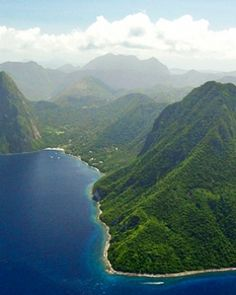 The way the mountains meet the water is so majestic. Castries, St. Lucia #Jetsetter #JSTakeMeThere