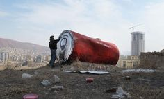 Giant can of Coca-Cola appears in Iran after Mahmoud Ahmadinejad declared a ban on American companies including Coca-Cola. Designed by Iran-base muralist Icy and Sot.