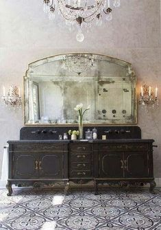 black vanity with huge antique mirror