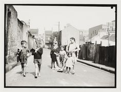 Children in Sydney slums, mainly Surry Hills, Woolloomooloo, Redfern, 1949 by Ted Hood Old Pictures, Old Photos, Vintage Photographs, Vintage Photos, Sydney Photography, Black History Books, Nasa History, Surry Hills, Slums