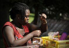 A Nigerian women seeking #asylum in the Czech Republic learns how to bead. © UNHCR/B. Szandelszky