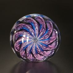 Blue and Purple Paperweight by The Glass Forge. With a hypnotic swirl of color, this flattened blown glass disk is entrancingly detailed. Each is unique and will vary. Purple Art, Shades Of Purple, Purple Glass, Glass Marbles, Glass Beads, Snail Art, Sandblasted Glass, Egg Art, Glass Paperweights