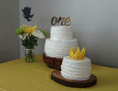 Rustic two tier cakes on log slice cake servers. Where The Wild Things Are birthday cake and smash cake.