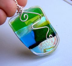 Like this simple wire wrap on a fused glass pendant