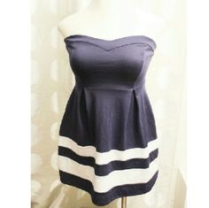 Monteau Strapless Navy Blue Dress Beautiful strapless Navy blue dress with white stripes on bottom.  Zipper closure on bavk75% Polyester 18% Rayon 4% Spandex Monteau Dresses Strapless
