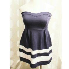Monteau Strapless Navy Blue Dress Beautiful strapless Navy blue dress with white stripes on bottom.  Zipper closure on bavk75% Polyester 18% Rayon 4% Spandex Monteau Dresses Strapless