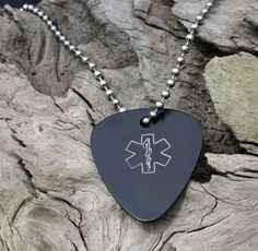 """Guitar Pick medical id alert necklace is not only fun, but also a unique medical necklace that is perfect for boys, girls as well as adults.    Now your rock star music fan can really enjoy wearing their medical alert jewelry with their very own guitar pick med id alert necklace!    Our new fun stylish guitar pick medical alert jewelry necklace is anodized aluminum, measures 1 5/16 x 1 1/8"""" and is available is your choice of colors."""