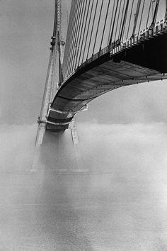"Jean Gaumy. FRANCE. Seine-Maritime. 1994. The "" Pont de Normandie"". A suspension bridge with span of 856 meters, across the Seine River estuary."