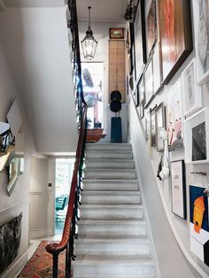Waiting for our staircase renovation and then putting all our photos on the wall. Have them in storage at the moment. Looks great!