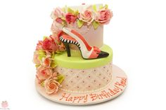 Fashion inspired 90th birthday cake with cascading roses and slighback shoe. Happy Birthday Rose!