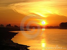 Photo about Golden glowing sunset with reflections over the water. Image of brilliant, dayspring, reveille - 17476013 Reflection, Sunrise, Glow, River, Celestial, Stock Photos, Photography, Outdoor, Image