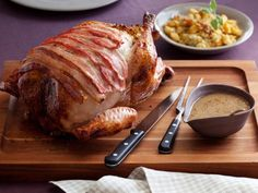 Get Maple-Roasted Turkey with Sage, Smoked Bacon, and Cornbread Stuffing Recipe from Food Network