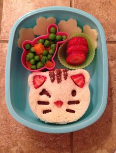 Toddler Bento Box: Preschool Lunch Idea.  Nutella and strawberry sandwich on fresh egg bread, peas and carrots, sliced strawberries and jack cheese.