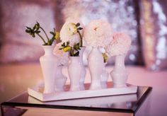 Simple tray of white vases and flowers makes for a pretty centerpiece. Photo by Randy Coleman Photography. #wedding #white #centerpiece
