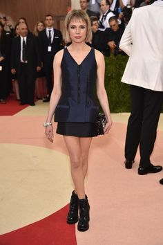 Michelle Williams in a Louis Vuitton dress and Cartier jewelry