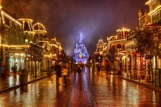 DLRP Feb 2009 - Main Street and the Castle on a rainy Night by PeterPanFan, via Flickr