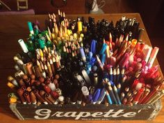 markers in a vintage Grapette box