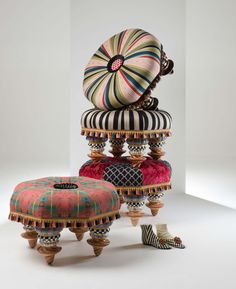 Putting your feet up feels so good! Putting them up on a footstool with handmade and hand-painted ceramics, and hand upholstered textiles combined in elegantly quirky MacKenzie-Childs designs feels even better.