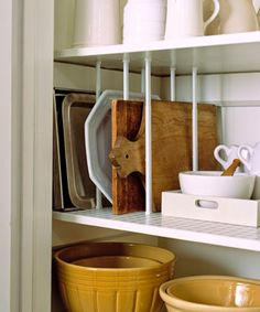 Curtain tensions rods fitted in between shelves in a pantry create vertical stor… - home office organization diy Kitchen Storage Hacks, Small Kitchen Organization, Kitchen Cabinet Organization, Home Office Organization, Organization Ideas, Kitchen Cabinets, Organization Store, Kitchen Hacks, Kitchen Gadgets