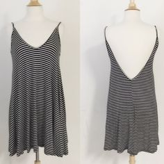 Adorable! Navy and White Striped Dress low V back This dress is soooooo cute with the low v back and v neck front too.  Spaghetti straps and cute navy and white stripes makes this perfect for summer! Great over a swimsuit for a day at the beach or wear with a cute bandeau or Bralette for a great look anytime! Size is small.  Material is 96%rayon and 4%spandex. made in USA! Hand wash and line dry is recommended.  Thanks for visiting my closet and feel free to ask any questions💕☀️🌻😘 April…