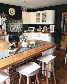 Dark walls in contrast to the white kitchen units with patterened back splash, brick effect wallpaper under the island and ikea runner. Home Decor Kitchen, Kitchen And Bath, New Kitchen, Kitchen Dining, Dining Table, Kitchen Units, Kitchen Cabinets, Updated Kitchen, Küchen Design