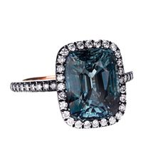 FRANCE Contemporary Superb 6.08cts blue/green Sapphire solitary cushion cut mounted in a pink gold and silver rhodiated setting, paved with small diamonds on bezel and ring. Price $15000