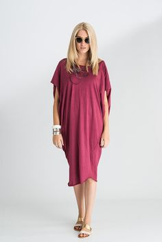 Round neck, cap sleeve, loose fitting asymetrical cut hem dress.  100% Thinweight Cotton Jersey  Made in one size.  Gentle wash.  Dry cleanable  Please note that computer resolutions and monitors may cause colours to vary slightly.  CK & Co. EXCLUSIVE! Only sold through Celia Kate & Co.   Size 1  Shoulder 110cm  Centre Length Back 83cm  Armhole 34cm   Model wears size 1    Thank you for visiting my gallery.