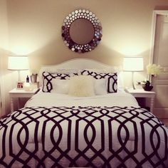 ♥ A bed is a perfect place for bold and big patterns. Gorgeous mirror, too.