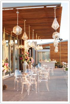 Luxe Modern furniture, ghost chairs, and lighting for cocktail hour a La Jolla beach wedding I'm digging the lights