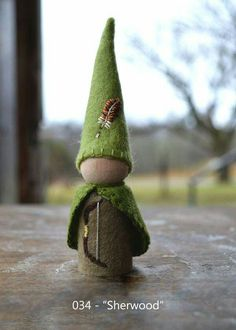 """""""Sherwood"""" -- peg gnome handmade from wool felt, wooden peg, and cotton floss. (front)"""