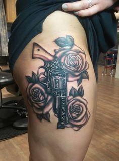 Gun and roses tattoo done by Anna Carlson at Crimson Heart Designs Tattoo Studio, Turtle Lake, WI